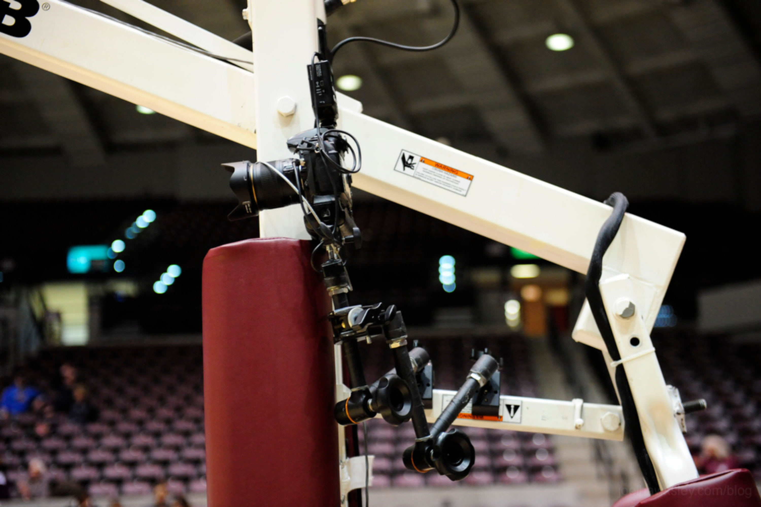 Nikon camera mounted to the post of a basketball hoop, viewed from the side